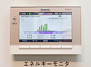 "An ""energy monitor"" shows energy usage, savings and other readouts from electrical devices in the ""all electrical"" system displayed at Panasonic Corp.'s  showroom  in Tokyo, Japan on Wednesday 14 Oct.  2009. Panasonic plans to invest $1 billion by 2012 in a plan to make its min line of business equipping homes and buildings with solar power and other energy-saving technologies. The new ""all electrical"" technology allows consumers to monitor their own electricity use."