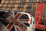 rear of a National Express coach with decorations and flags on the frant of Harrods department store, Knightsbridge in the week of the Queen's diamond Jubilee celebrations.