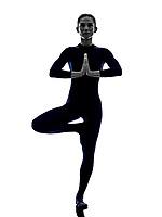 woman exercising Vrksasana tree pose yoga silhouette shadow white background