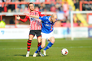 Exeter City's Ryan Harley and Carlisle Utd's Jason Kennedy during the Sky Bet League 2 match between Exeter City and Carlisle United at St James' Park, Exeter, England on 12 March 2016. Photo by Graham Hunt.