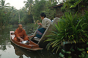 Monks on boats travel small klongs or canals collecting alms in the early morning. They stop beside the landings to collect food wherever it is offered.