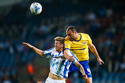 Jonathan Stead of Huddersfield and Ivan Ramis of Wigan compete in the air - Photo mandatory by-line: Rogan Thomson/JMP - 07966 386802 - 16/09/2014 - SPORT - FOOTBALL - Huddersfield, England - The John Smith's Stadium - Huddersfield Town v Wigan Athletic - Sky Bet Championship.