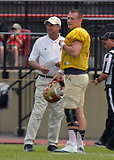 NCAA FCS: VMI football spring scrimmage - VMI head coach Sparky Woods confers with starting quarterback Eric Kordenbrock prior to the start of Saturday's scrimmage in Lexington.