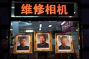 Mao photograph shown in the shopping window of a photo shop located at a public square in the center of Beijing. Beijing is the capital of the People's Republic of China and one of the most populous cities in the world with a population of 19,612,368 as of 2010.