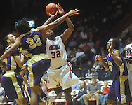 """Ole Miss guard Zach Graham (32) is fouled by Alcorn State's Michael Martin (33) at the C.M. """"Tad"""" Smith Coliseum in Oxford, Miss. on Thursday, December 29, 2010. (AP Photo/Oxford Eagle, Bruce Newman)"""