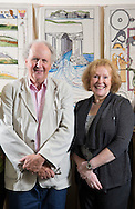 Alexander McCall Smith stands with Dorie Wilkie in front of finished panels stretching and in racks for the Great Tapestry of Scotland project. Photographed at the Hub in Eskbank<br /> www.scotlandstapestry.com<br /> <br /> pictures by Alex Hewitt