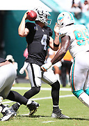 Sep 23, 2018; Miami Gardens, FL, USA; Miami Dolphins defensive end William Hayes (95) is about to sack Oakland Raiders quarterback Derek Carr (4) at Hard Rock Stadium. The Dolphins defeated the Raiders 28-20. (Steve Jacobson/Image of Sport)