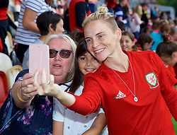 NEWPORT, WALES - Thursday, August 30, 2018: Wales' Jessica Fishlock poses for a selfie photograph with young supporters after a training session at Rodney Parade ahead of the final FIFA Women's World Cup 2019 Qualifying Round Group 1 match against England. (Pic by David Rawcliffe/Propaganda)