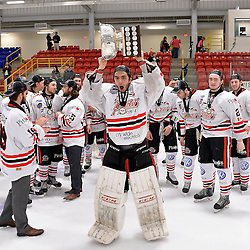 FORT FRANCES, ON - May 2, 2015 : Central Canadian Junior &quot;A&quot; Championship, game action between the Fort Frances Lakers and the Soo Thunderbirds, Championship game of the Dudley Hewitt Cup. Mario Culina #30 of the Soo Thunderbirds raises the Dudley Hewitt Cup.<br /> (Photo by Shawn Muir / OJHL Images)