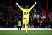 Brentford goalkeeper, David Button (27) celebrating during the Sky Bet Championship match between Brentford and Cardiff City at Griffin Park, London, England on 19 April 2016. Photo by Matthew Redman.