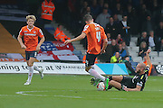 York City midfielder Russell Penn tackles Luton Town midfielder Jonathan Smith  during the Sky Bet League 2 match between Luton Town and York City at Kenilworth Road, Luton, England on 10 October 2015. Photo by Simon Davies.