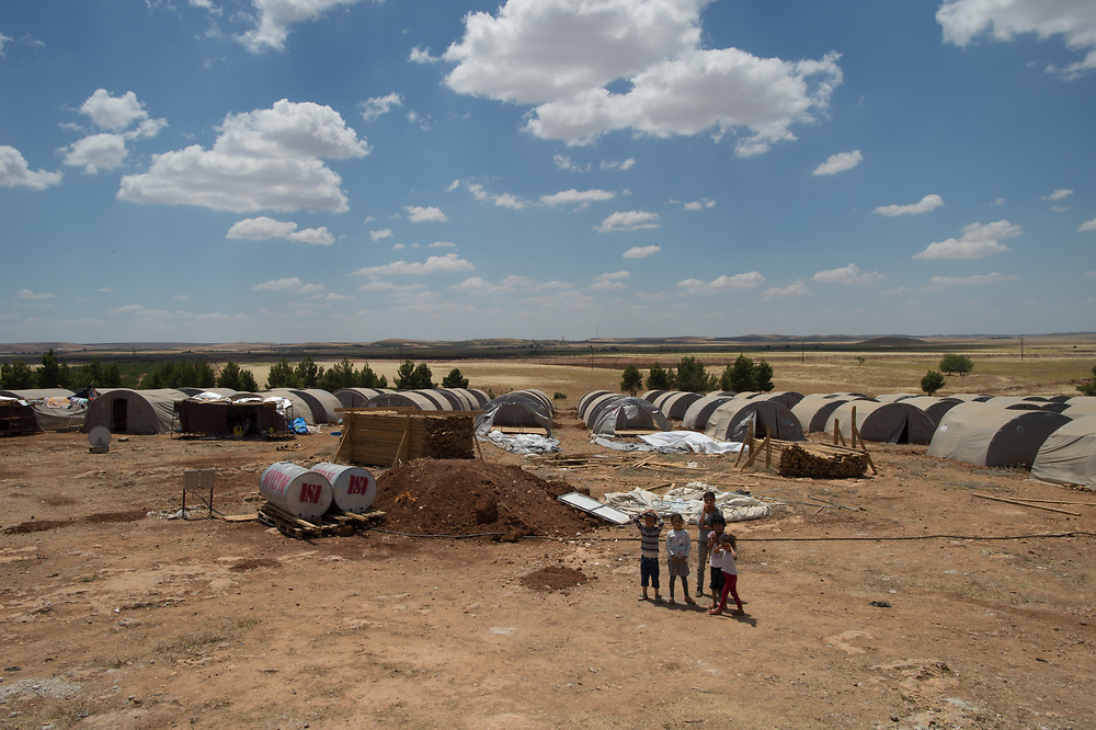 Approximately 35 families are living in 350 tents in the IDP camp in Kobane, which is organised by the canton administration of the town. Kobanê (Ayn al-Arab), Syria, June 20, 2015