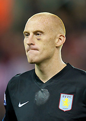 STOKE, ENGLAND - Monday, September 13, 2010: Aston Villa's James Collins with a black-eye sustained playing for Wales against Montenegro during the Premiership match against Stoke City at the Britannia Stadium. (Photo by David Rawcliffe/Propaganda)