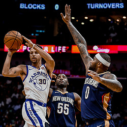 Oct 20, 2017; New Orleans, LA, USA; Golden State Warriors guard Stephen Curry (30) is defended by New Orleans Pelicans forward DeMarcus Cousins (0) and guard E'Twaun Moore (55) during the first quarter of a game at the Smoothie King Center. Mandatory Credit: Derick E. Hingle-USA TODAY Sports
