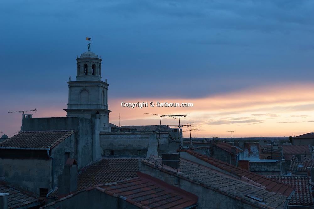 France. Bouches du Rhone.Arles, the belfry of the city hall,  the old city rooftops view from a terrace,   France    /  Arles , le beffroi de la mairie, les toits de la vielle ville vus d une terrace