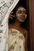 Sandalwood face mask worn by Madagascan woman to protect their skin and for beautification.<br />This is a Sakalava woman from the west coast.<br />MADAGASCAR