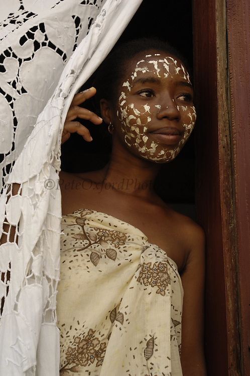 Sandalwood face mask worn by Madagascan woman to protect their skin and for beautification.<br />