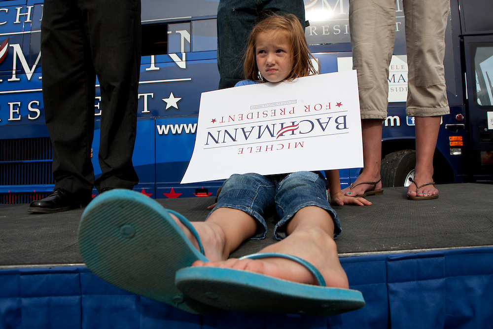 A girl listens to Republican presidential hopeful Michele Bachmann at a campaign stop on Tuesday, August 9, 2011 in Humboldt, IA.
