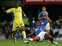 Photo: Lee Earle.<br /> Portsmouth v Leeds United. Carling Cup. 28/08/2007.Portsmouth's Noe Pamarot (R) slides in on Tresor Kandol.
