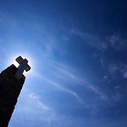 The sun behind the cross at that Cabo da Roca marker in Sintra. The westernmost point of the European landmass and the last bit of the continent sailors would see when heading out towards the sea.
