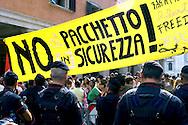 Roma 1 Luglio 2009.Manifestazione della Rete anti G8 davanti al  Senato per protestare contro l'approvazione del Pacchetto Sicurezza che  comprende norme contro gli immigrati..Manifestation of the anti G8 network under the Senato to protest against the security package which contain rules against migrants