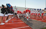 Washington's Noah Dostal (11) and LaVonte Batte (63) lead the team onto the field during the game between Cedar Falls and Cedar Rapids Washington at Kingston Stadium in Cedar Rapids on Friday, September 7, 2012.