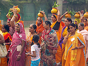 A Kalash Yatra in Agra, India. The kalash (the pot some of the women are carrying on their head) is a Hindu religious symbol.