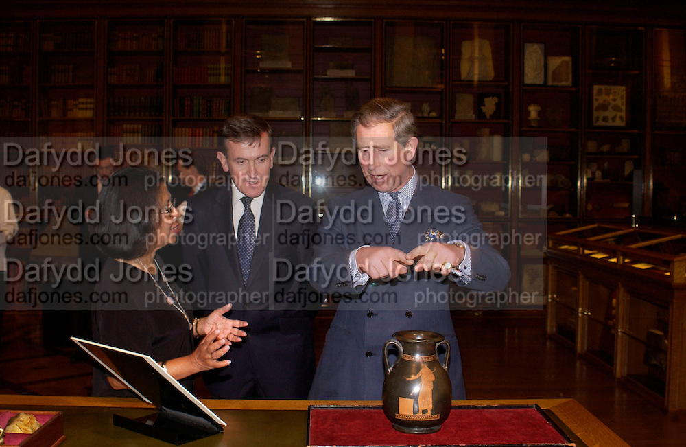 HRH Prince of Wales , Official opening of the Enlightenment Gallery and the exhibition 'Discovering the World in the Eighteenth Century' in the restored KIng's Library by Prince Charles. British Museum. 11 December 2003. © Copyright Photograph by Dafydd Jones 66 Stockwell Park Rd. London SW9 0DA Tel 020 7733 0108 www.dafjones.com