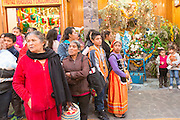 Crowds of onlookers gather to watch the Three Kings bless a baby Jesus doll during El Dia de Reyes January 6, 2016 in San Miguel de Allende, Mexico. The traditional festival marks the culmination of the twelve days of Christmas and commemorates the three wise men who traveled from afar, bearing gifts for the infant baby Jesus.