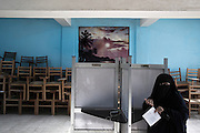 A conservative Egyptian woman casts her vote during the second day of the historic democratic Presidential election May 24, 2012 in the Imbaba district of Cairo Egypt.  The results of the election will help determine to what extent religion will play a role in politics throughout the country. (Photo by Scott Nelson)