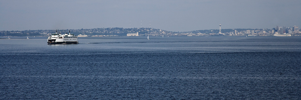 A Washington State Ferry crosses Puget Sound from Seattle (in the background) to Bainbridge Island.