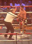 Picture by Richard Gould/Focus Images Ltd +44 7855 403186<br /> 13/07/2013<br /> Tommy Coyle (black &amp; gold) is counted out by the ref fight for the vacant Commonwealth Lightweight title at Craven Park, Hull.