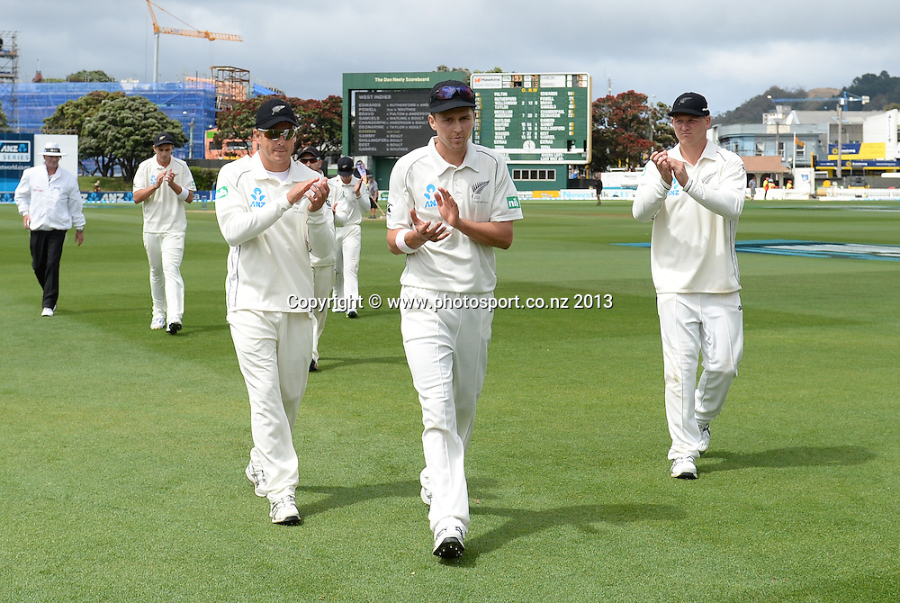 Trent Boult leads the team from the field after taking a five wicket bag and fiqures of 6/40 on Day 3 of the 2nd cricket test match of the ANZ Test Series. New Zealand Black Caps v West Indies at The Basin Reserve in Wellington. Friday 13 December 2013. Mandatory Photo Credit: Andrew Cornaga www.Photosport.co.nz