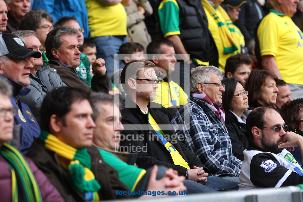 The traveling Norwich fans look fed up during the Barclays Premier League match at the Liberty Stadium, Swansea<br /> Picture by Paul Chesterton/Focus Images Ltd +44 7904 640267<br /> 29/03/2014