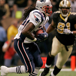 2009 November 30: New England Patriots running back Laurence Maroney (39) runs as New Orleans Saints defensive end Will Smith (91) pursues on the play during a 38-17 win by the New Orleans Saints over the New England Patriots at the Louisiana Superdome in New Orleans, Louisiana.