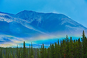 Rainbow and the Canadian Rocky Mountains. <br />David Thompson Highway<br />Alberta<br />Canada