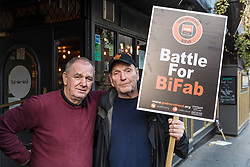 Following the march on Holyrood by BiFab workers who face redundancy contractors from the threatened plant, Ran O'Donnell and Ian Mitchell carry on the protest across the road from the Scottish Parliament on the Canongate