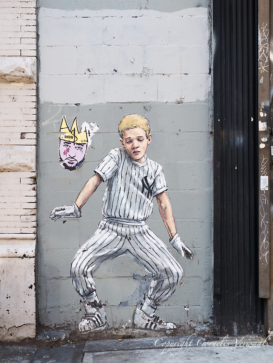 Mural depicting a young baseball player, seen on the upper westside of Manhattan