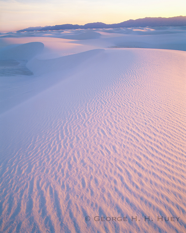 0213-1003B ~ Copyright: George H. H. Huey ~ Wind ridges in gypsum dunes at sunset with San Andres Mountains. White Sands National Monument, New Mexico.
