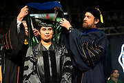 Thanuja Dilhani Mallikarachchi is hooded by her Ph. D. advisor Guy Reifler during graduate commencement ceremonies. Photo by Ben Siegel