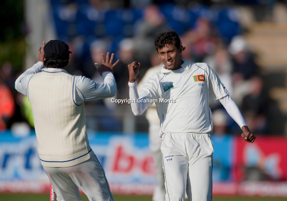 Bowler Suranga Lakmal (right) celebrates the wicket of Andrew Strauss during his century in the first npower Test Match between England and Sri Lanka at the SWALEC Stadium, Cardiff.  Photo: Graham Morris (Tel: +44(0)20 8969 4192 Email: sales@cricketpix.com) 27/05/11