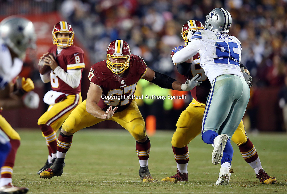 Washington Redskins center Josh LeRibeus (67) pass blocks for Washington Redskins quarterback Kirk Cousins (8) during the 2015 week 13 regular season NFL football game against the Dallas Cowboys on Monday, Dec. 7, 2015 in Landover, Md. The Cowboys won the game 19-16. (©Paul Anthony Spinelli)