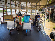 24 AUGUST 2014 - BANGKOK, THAILAND:     Food vendors wait for a ferry to take them across the Chao Phraya River from the Bangkok side to the Thonburi side. They got on at the Chinatown pier. PHOTO BY JACK KURTZ
