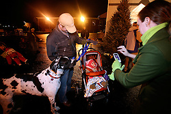 "Jen Woodruff, right, makes a photo of her 8 month old daughter Isla with her iPhone while Great Dane ""Otto"", left, and husband Rob look on. Isla was attending ""Holiday on Gaslight Square"" for the first time.  (By Jonathan Palmer, Special to The Courier-Journal) December 6, 2008"