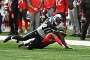 Carolina Panthers Wide Receiver Curtis Samuel (10) makes a hit during the International Series match between Tampa Bay Buccaneers and Carolina Panthers at Tottenham Hotspur Stadium, London, United Kingdom on 13 October 2019.