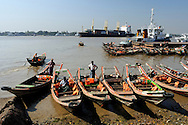 Myanmar, Yangon. Boats in the port at Yangon River.