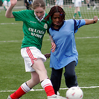 Kilnaboy's Leanne Nash and Cloughleigh's Jummy Ankintola go head to head at the Ribena  5 aside national soccer blitz in Lees Road on Wednesday.<br /><br /><br /><br />Photograph by Yvonne Vaughan.