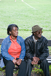 Older couple taking a break from a walk in the park together,