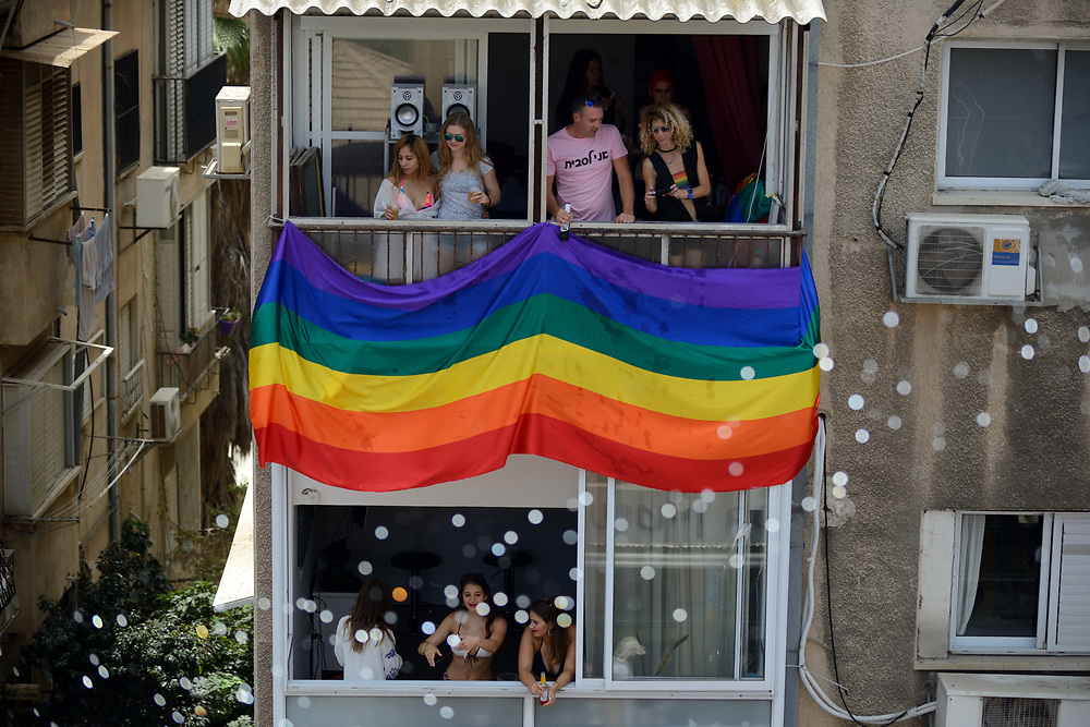 Israelis watch from balconies during the annual gay pride parade in Tel Aviv, June 09, 2017. About 200,000 members of the Israeli and international gay community participated the annual gay pride parade in Tel Aviv. Photo by Gili Yaari