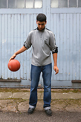 Youth bouncing a basketball,